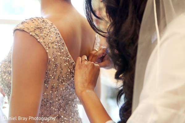Bridesmaid getting dressed in White Castle, LA Fusion Wedding by Daniel Bray Photography