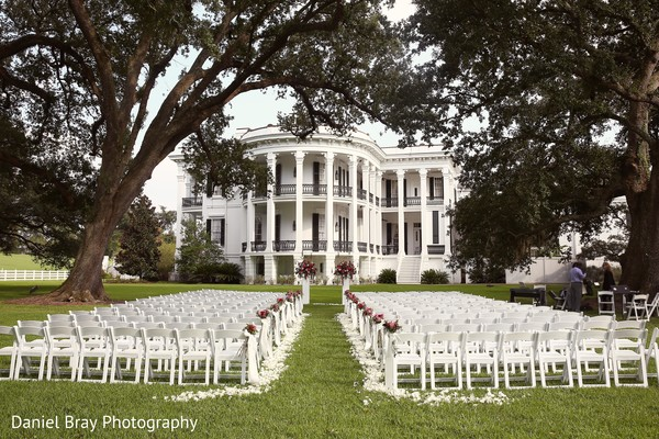Outdoor wedding ceremony in White Castle, LA Fusion Wedding by Daniel Bray Photography