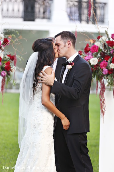 Ceremony kiss in White Castle, LA Fusion Wedding by Daniel Bray Photography