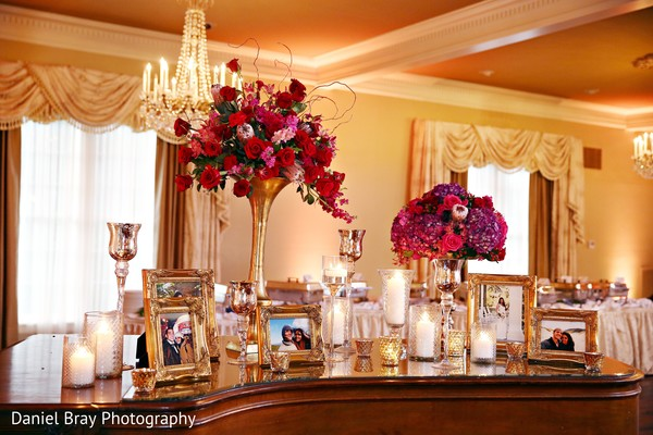 Photo display decor in White Castle, LA Fusion Wedding by Daniel Bray Photography