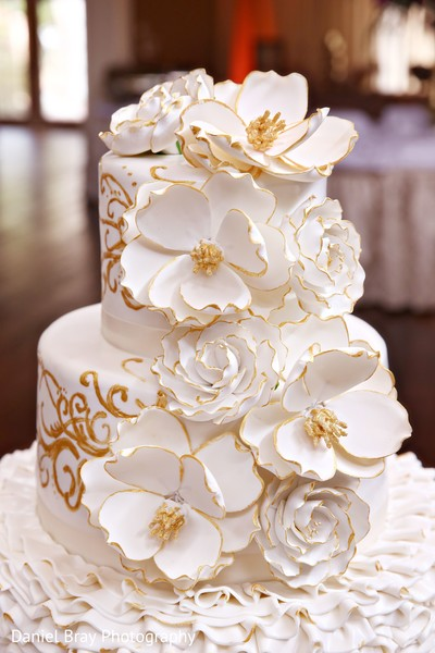 White gold wedding cake in White Castle, LA Fusion Wedding by Daniel Bray Photography