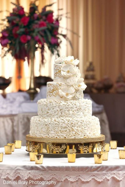 ruffled cake,four tiered cake,layered cake,cake with rosettes,ivory roses,gold roses,wedding cake,cake,cake table decor