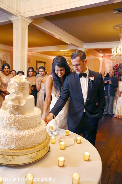 Cutting the cake in White Castle, LA Fusion Wedding by Daniel Bray Photography