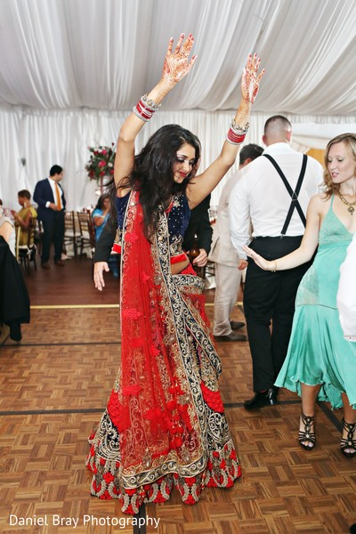 indian bride,indian lengha,indian bride dancing,red wedding lengha,red bridal lengha,red lengha,red lehenga,bridal fashions