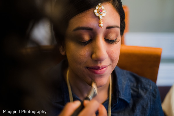 See this indian bride get her make up ready for her wedding. in Bethlehem, Pennsylvania Indian Wedding by Maggie J Photography