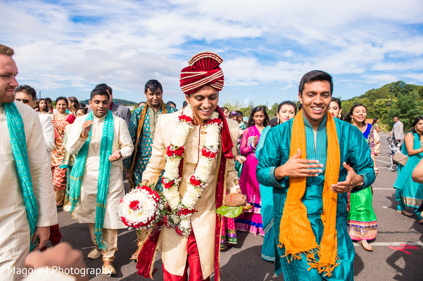 Handsome indian groom escorted by friends and family during baraat procession. in Bethlehem, Pennsylvania Indian Wedding by Maggie J Photography