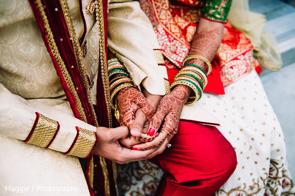 Lovely image of indian newlyweds holding hands. in Bethlehem, Pennsylvania Indian Wedding by Maggie J Photography