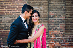 Cute image of indian bride and groom ready for their wedding reception.
