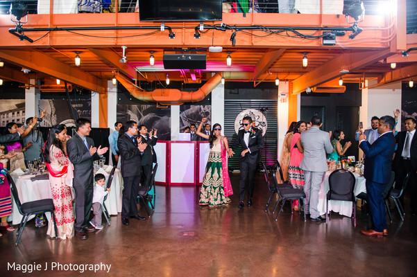 Original entrance of indian bride and groom to their wedding reception. in Bethlehem, Pennsylvania Indian Wedding by Maggie J Photography