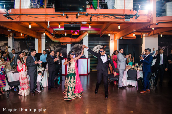 Indian bride and groom dancing white their enter their wedding party. in Bethlehem, Pennsylvania Indian Wedding by Maggie J Photography