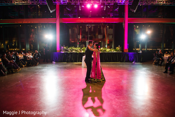 Perfect purple and blue lighting for this indian couple enjoy their first dance. in Bethlehem, Pennsylvania Indian Wedding by Maggie J Photography