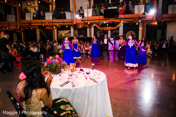 Indian groom dancing in a great choreography  for his lovely bride. in Bethlehem, Pennsylvania Indian Wedding by Maggie J Photography