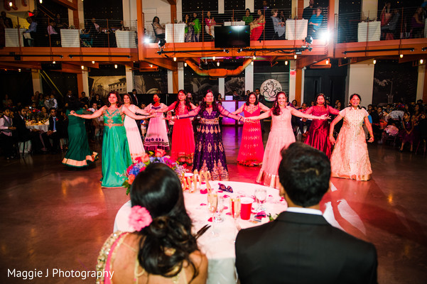 Special performance of family members at the wedding reception. in Bethlehem, Pennsylvania Indian Wedding by Maggie J Photography