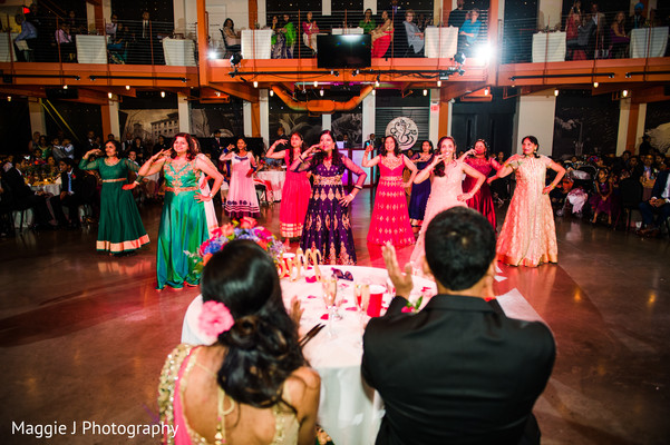Indian bride and groom enjoying of dancing performances. in Bethlehem, Pennsylvania Indian Wedding by Maggie J Photography