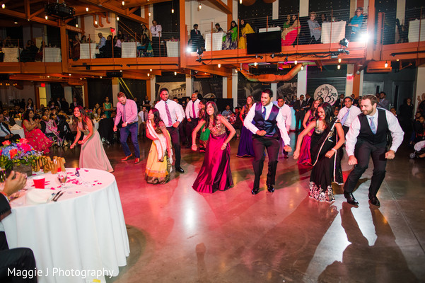 Family members performing at indian wedding reception. in Bethlehem, Pennsylvania Indian Wedding by Maggie J Photography