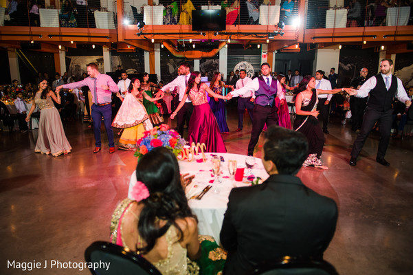 Nice choreography of family members at indian wedding reception. in Bethlehem, Pennsylvania Indian Wedding by Maggie J Photography