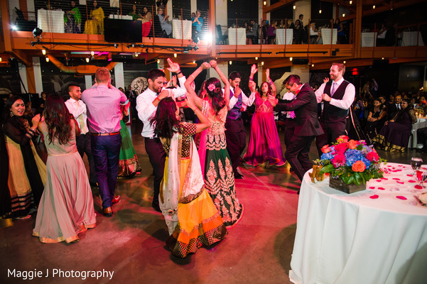 Indian bride and groom dancing along with family and friends. in Bethlehem, Pennsylvania Indian Wedding by Maggie J Photography
