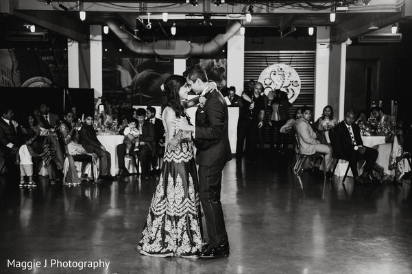 Black and white photography of indian bride and groom dancing. in Bethlehem, Pennsylvania Indian Wedding by Maggie J Photography