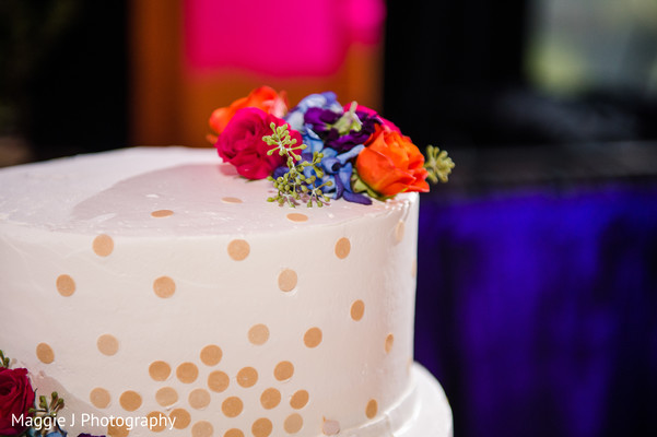 Lovely indian white wedding cake with flowers on top. in Bethlehem, Pennsylvania Indian Wedding by Maggie J Photography