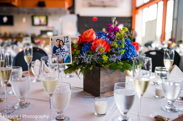 Orginal and romantic floral centerpiece. in Bethlehem, Pennsylvania Indian Wedding by Maggie J Photography