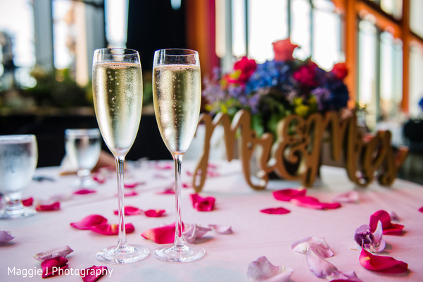 Elegant champagne glasses ready to toast. in Bethlehem, Pennsylvania Indian Wedding by Maggie J Photography