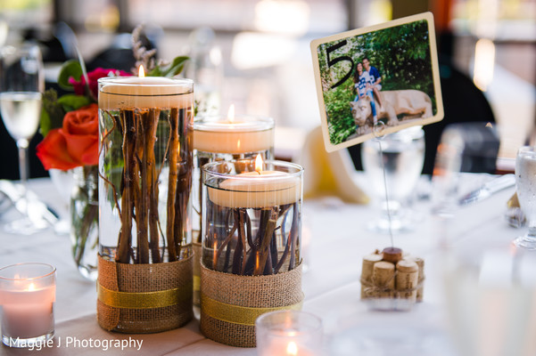 Sweet candle rustic centerpiece. in Bethlehem, Pennsylvania Indian Wedding by Maggie J Photography