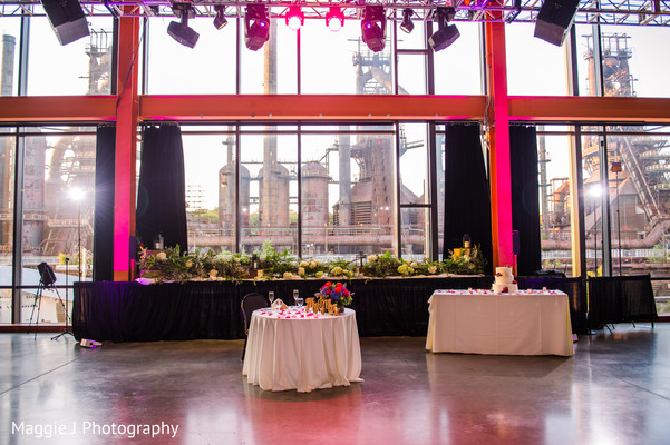 Indian wedding reception venue main stage decoration. in Bethlehem, Pennsylvania Indian Wedding by Maggie J Photography