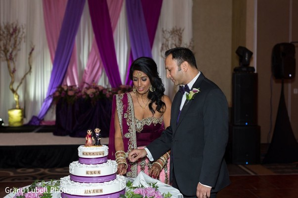 Indian Bride and Groom Cutting Cake in Perrysburg, OH Indian Fusion Wedding by Grand Lubell Photography
