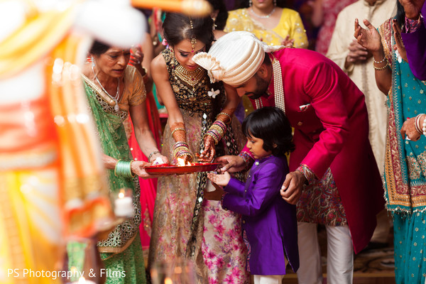 Bride and groom in Sangeet in Palm Bech, FL Indian Wedding by PS Photography & Films