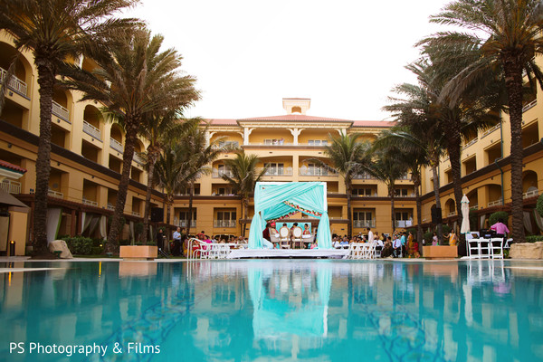 Lovely Indian wedding ceremony setting by the pool in Palm Bech, FL Indian Wedding by PS Photography & Films