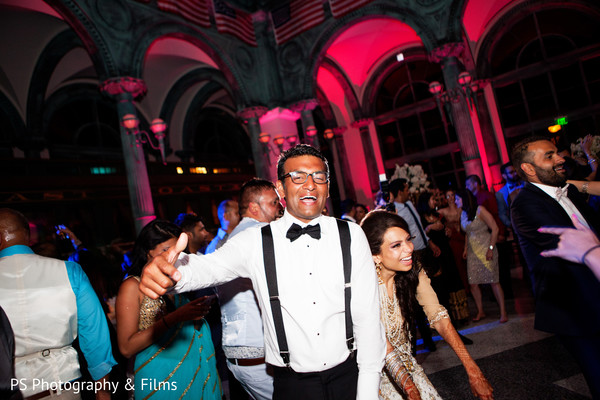 Getting the party started in indian wedding reception in Palm Bech, FL Indian Wedding by PS Photography & Films