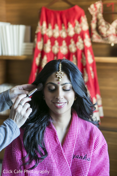 Beautiful indian bride getting ready for her wedding ceremony. in Jersey City, NJ Indian Wedding by Click Café Photography