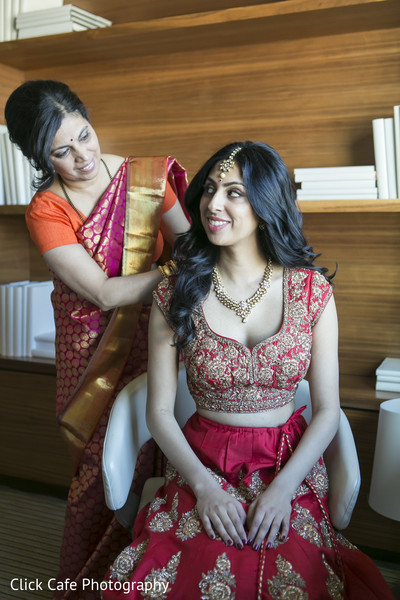 Beautiful indian bride ready in her red traditional bridal attire.