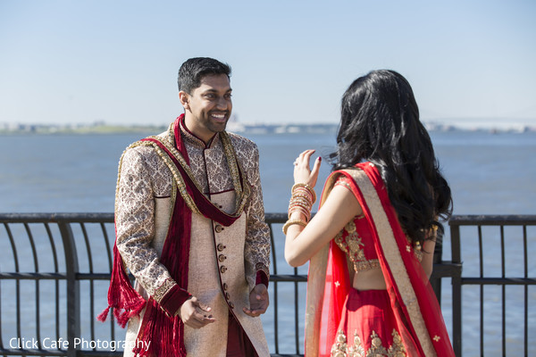 Indian bride and groom first look. in Jersey City, NJ Indian Wedding by Click Café Photography