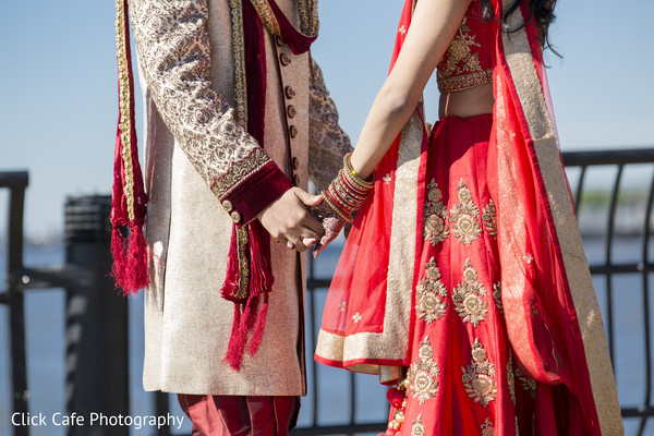 Indian bride and groom holding hands. in Jersey City, NJ Indian Wedding by Click Café Photography
