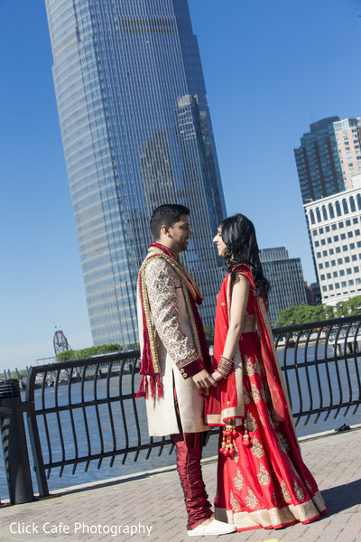 Beautiful indian bride and groom in red wedding outfits. in Jersey City, NJ Indian Wedding by Click Café Photography