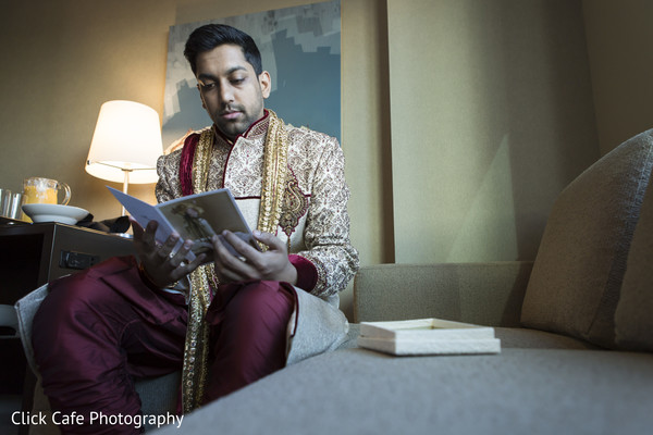 Indian groom reading card from his bride. in Jersey City, NJ Indian Wedding by Click Café Photography