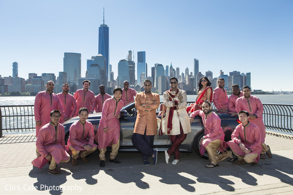 Groomsmen wearing pink and gold outfits. in Jersey City, NJ Indian Wedding by Click Café Photography