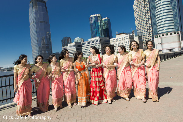 Indian bride with her beautiful bridesmaids wearing pink and golden serees. in Jersey City, NJ Indian Wedding by Click Café Photography