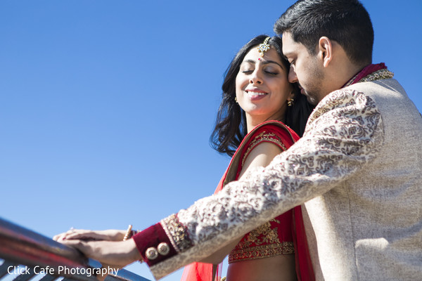 Romantic shot of Indian bride and groom in Jersey City, NJ Indian Wedding by Click Café Photography