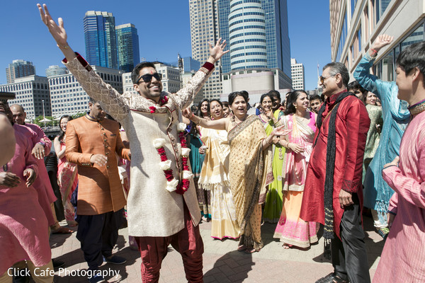 Happy indian groom dancing during his traditional baraat. in Jersey City, NJ Indian Wedding by Click Café Photography