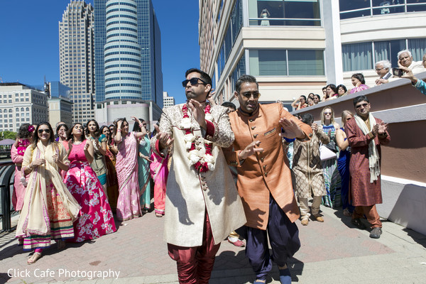 Indian best man dancing and escorting the groom. in Jersey City, NJ Indian Wedding by Click Café Photography