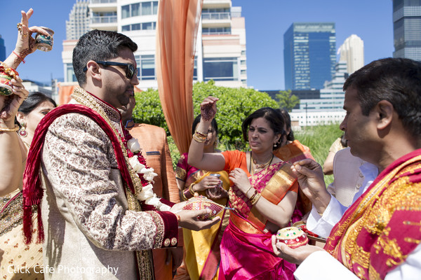 Indian groom being welcomed by the bride's family. in Jersey City, NJ Indian Wedding by Click Café Photography