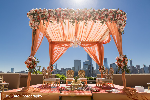 indian wedding mandap,indian wedding ceremony,orange mandap,flowered mandap