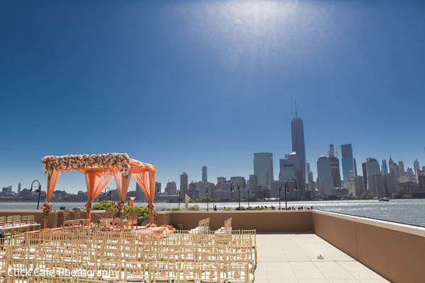 Fantastic view of NYC skyscrapers in Indian wedding ceremony. in Jersey City, NJ Indian Wedding by Click Café Photography
