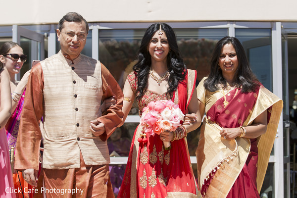 Beautiful indian bride making her entrance to the wedding ceremony. in Jersey City, NJ Indian Wedding by Click Café Photography