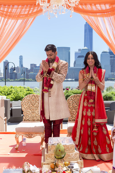 Sweet indian bride and groom during their wedding ceremony. in Jersey City, NJ Indian Wedding by Click Café Photography