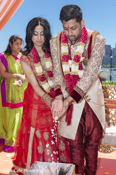 Indian bride and groom wedding ceremony moment. in Jersey City, NJ Indian Wedding by Click Café Photography
