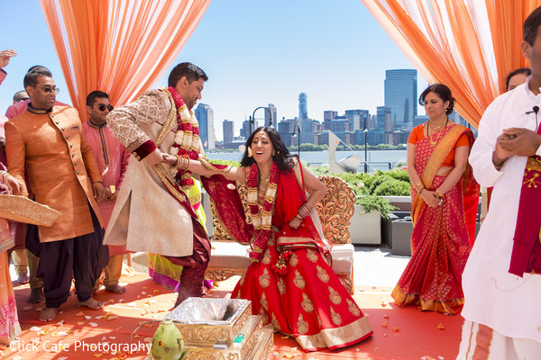 Indian bride and groom during their traditional wedding ceremony. in Jersey City, NJ Indian Wedding by Click Café Photography
