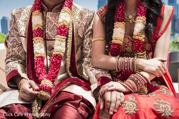 Perfect picture of indian bride and groom holding hands during wedding ceremony. in Jersey City, NJ Indian Wedding by Click Café Photography